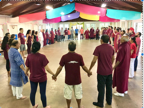 "At the Mathur family's meditation center, people of all ethnic backgrounds gather and hold hands to meditate together. ""Meditation helps people learn how to cope with life and clear excess thoughts and baggage,"" sophomore Vedika Mathur said."