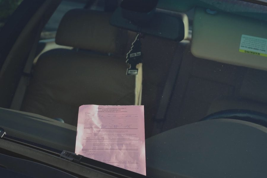 Yesterday, students went to the parking lot after classes were over, ready to leave a hard days work, and saw a sea of pink. Pink parking tickets were scattered on cars all over the parking lot to those that did not obtain a new parking pass for the spring semester.