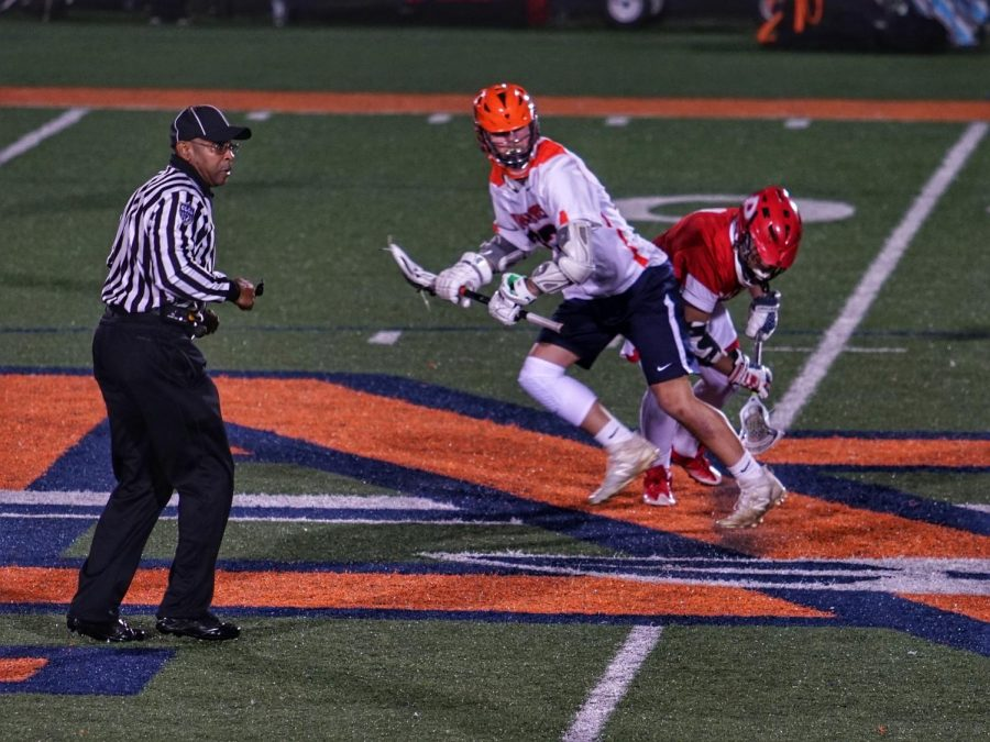 "Noah McKouen, faceoff midfielder, wins faceoff at NC. ""It's a lot of hard work playing college sports, but I know he has the determination and focus for what is to come! I hope he stays healthy and strong, but mostly, I hope he is happy,"" Sara McKouen said."