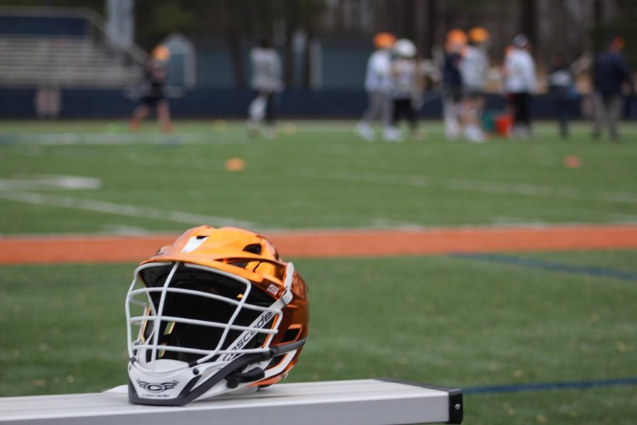 With+a+new+season+comes+new+gear.+Starting+off+the+season+with+new+chrome+orange+helmets%2C+the+boys+varsity+lacrosse+team+eagerly+awaits+their+first+game.+Head+Coach+John+Almy+hopes+that+the+seniors+will+take+the+reins+and+lead+the+team+to+several+victories.+%E2%80%9CI+just+hope+to+see+growth+from+last+year+and+see+the+senior+class+take+the+step+up+and+be+leaders%2C%E2%80%9D+Coach+Almy+said.+The+Warriors+will+play+their+first+game+against+Wheeler+on+Wednesday%2C+February+6.