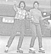 From the January 1980 issue of The Chant, two students skate their way through the class offered at North Cobb. Sporting plaid and bright white skates, students wore the trendy styles that accompanied rollers at the rink.