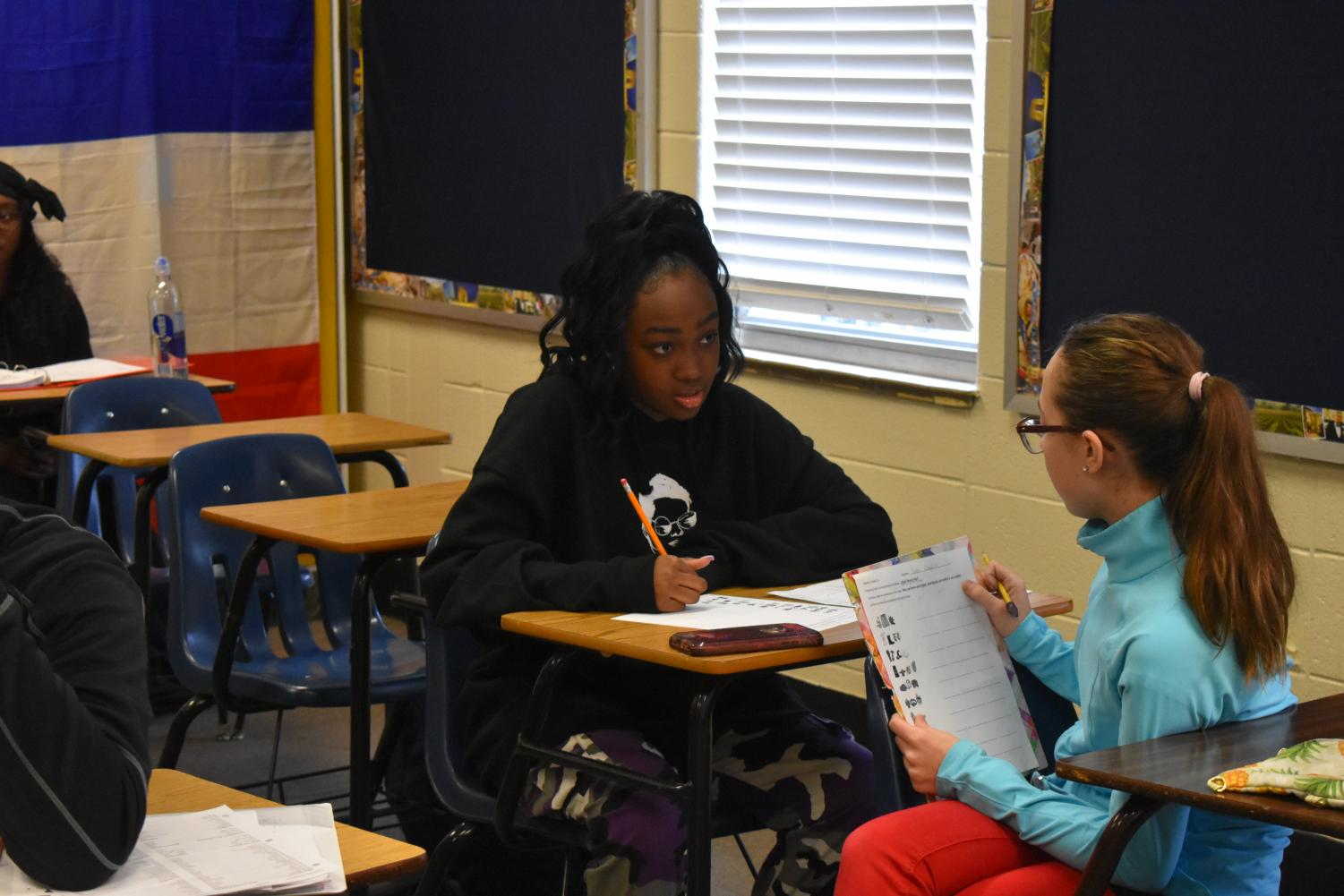 Anaya Cheyenne participates in an activity for Ms. Cotton's 3rd period Spanish class. Despite living the life of a singer, Davis still must meet all the requirements demanded of a NC sophomore. When prompted on how she balances school with work, she noted the exceedingly demanding schedule she follows, though she still manages to keep up.