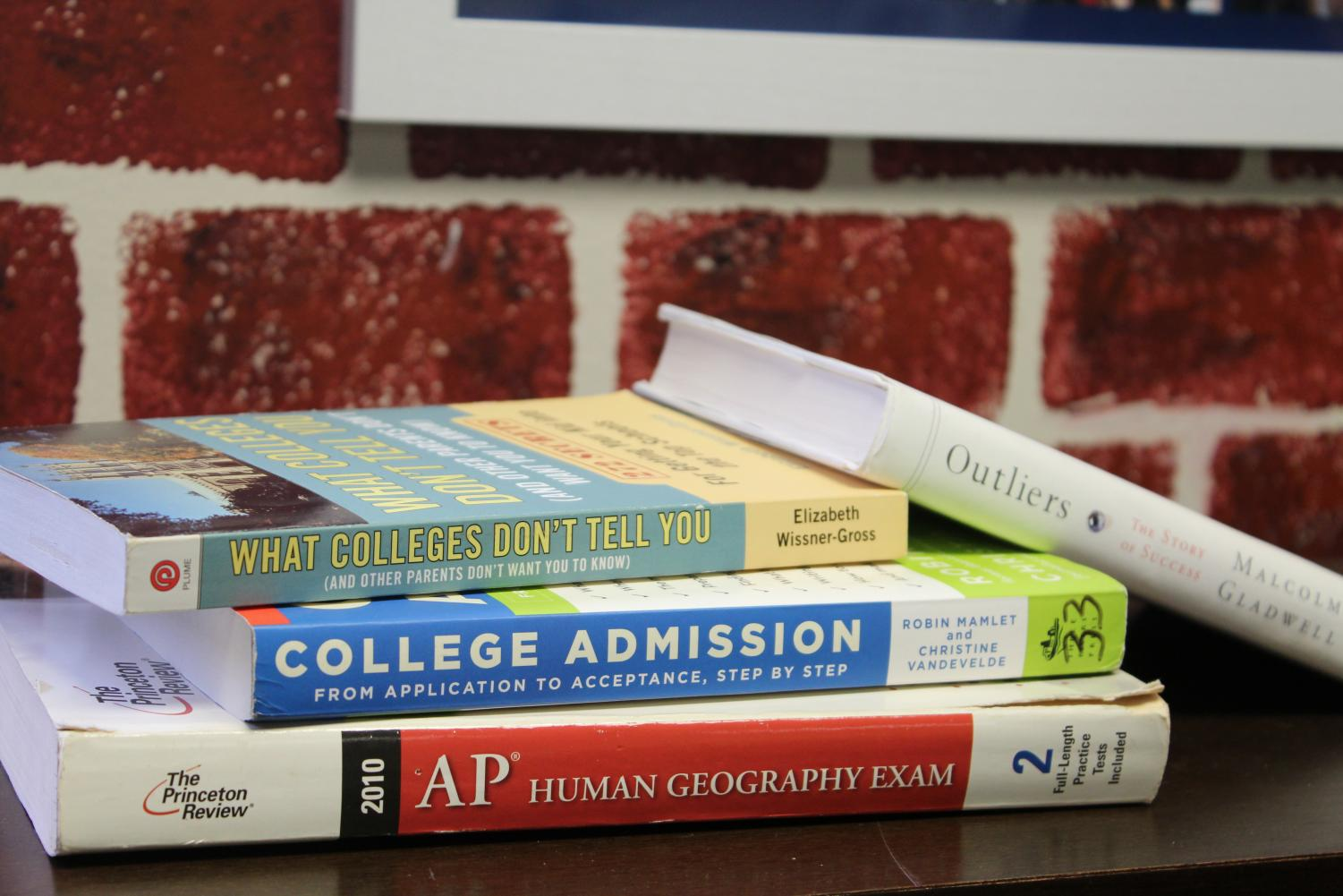 """As a requirement for their freshman curriculum, all ninth grade magnet students must take AP Human Geography, a course taught primarily by James Auld.   """"Historically, we have about anywhere from 95 to 100 percent of students [sign up for exams]. This year we have 83 out of 88 [students]. We still have to finish two whole units. Then they do a group collaborative study project outside of school that goes in as a comprehensive exam grade, and then we have after-school sessions for anyone and everyone that would like to come. So between those two, they have twelve different opportunities,"""" Auld said.  In addition to attending various study sessions and using the college prep and information books pictured above to ready themselves for their upcoming exams, students may also look to self-help books like Malcolm Gladwell's Outliers, for guidance. This influential book explains the secret to accessing the deepest facets of human potential, offering a fuller, more complex definition of success."""