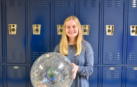 NC senior Rebekah Geil poses with a celestial sphere. Since a freshman-year trip to the U.S. Space and Rocket Center in Huntsville, Alabama, first piqued her interest, Geil has developed a passion for the world of space exploration. She now hopes to parlay her interest into a career as an aerospace engineer.