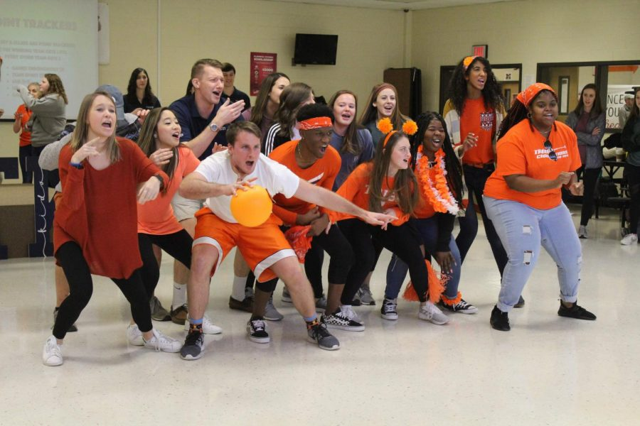 Seniors+dressed+up+in+orange+to+represent+their+class+color+and+hyped+up+the+crowd+to+start+the+FTK+dance+marathon.+%E2%80%9CThe+organization+is+very+special+in+the+way+that+they+help+the+community+and+so+many+people%2C%E2%80%9D+senior+hype+leader+Zion+Fitch+said.+