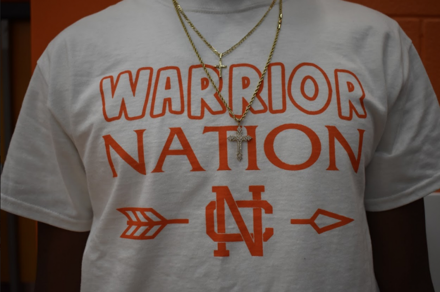 Senior+Josh+Hollis+represents+NC+by+wearing+TC%E2%80%99s+%E2%80%9Cwarrior+nation%E2%80%9D+shirt+at+the+pep+rally+friday.+Hollis+and+along+with+other+members+of+TC+plan+the+pep+rallies+and+do+a+great+job.+%0A