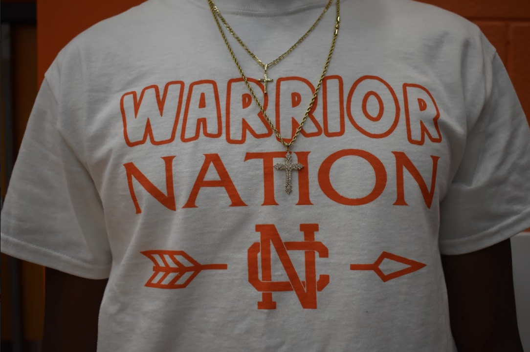 "Senior Josh Hollis represents NC by wearing TC's ""warrior nation"" shirt at the pep rally friday. Hollis and along with other members of TC plan the pep rallies and do a great job."