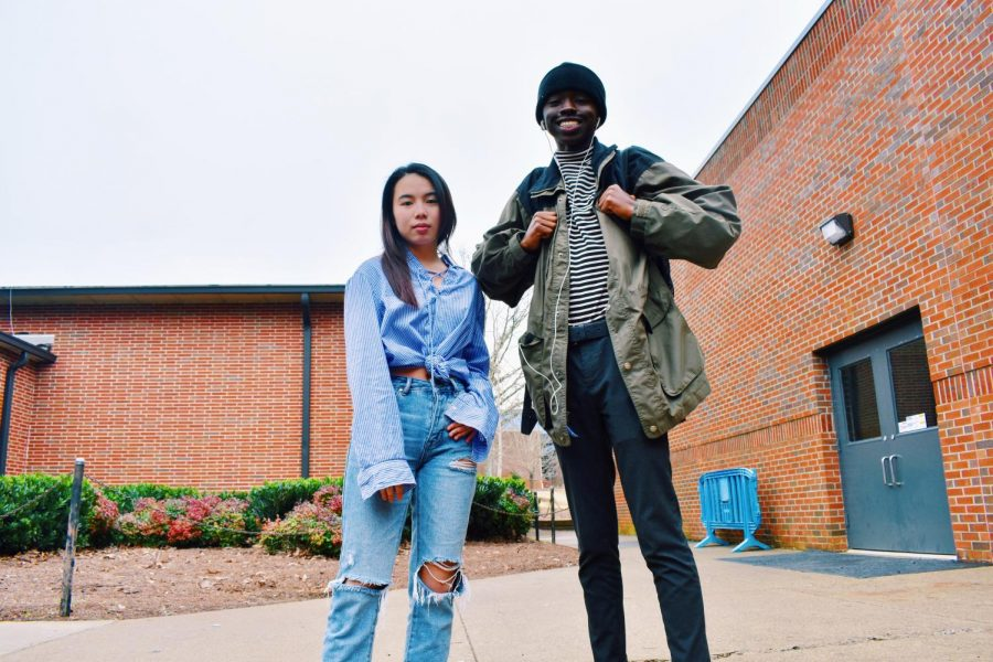 Juniors Trisha Nguyen and Baldwin Ndogo flaunt casual street-wear to NC, clearly updated on the the latest trends. Nguyen wears ripped boyfriend-style jeans with a simple, yet cute, long sleeve polo. Ndogo shows off a 90s-inspired fit with a vintage Ralph Lauren polo and a green-colored windbreaker.