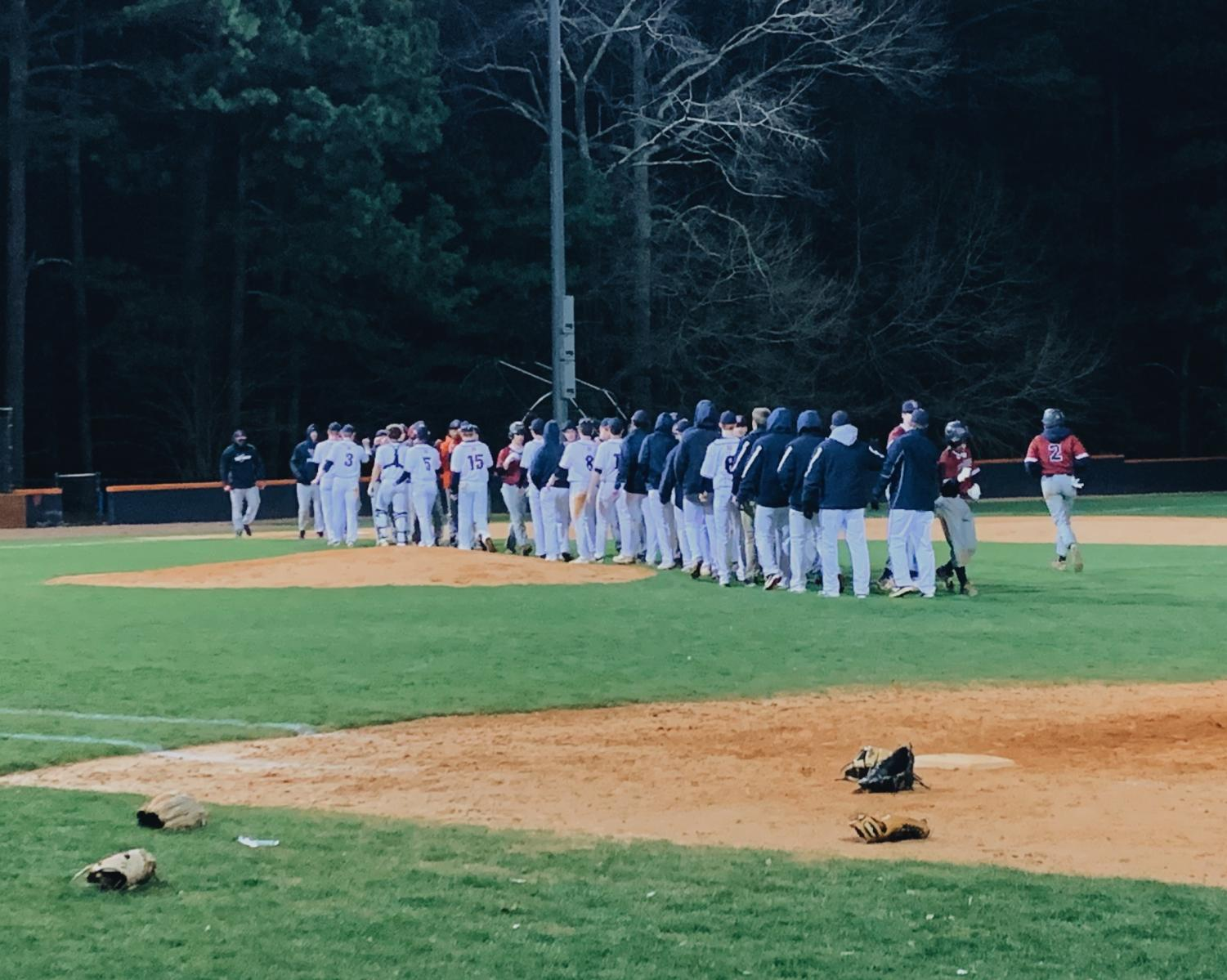 "NC Varsity Warriors celebrated a win against the Woodstock Wolverines on Tuesday, March 5. ""Woodstock isn't what they were last year and we showed them that. I felt good during the game, the team had my back and we produced when we needed it,"" senior pitcher Jonathan Young said."