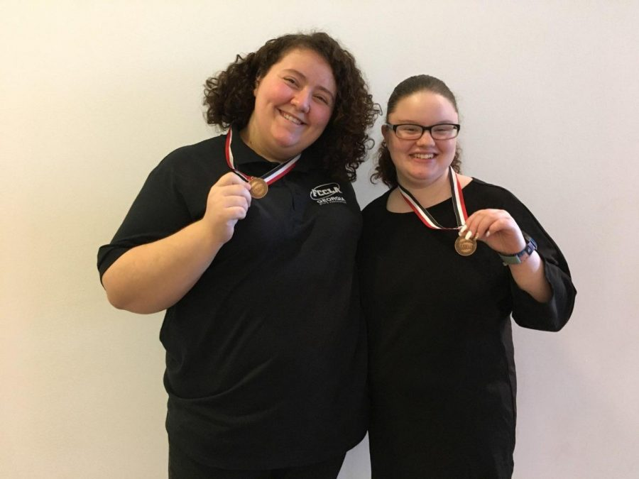 NC+juniors+Laney+Robitzsch+and+Tatiana+Londo%C3%B1o+smile+after+receiving+their+bronze+medals+from+attaining+the+9th+position+at+the+annual+FCCLA+state+competition.+Sophomore+Kiara+Kisor%2C+the+original+team+member%2C+could+not+savor+this+moment+with+her+partner+due+to+health+issues+but+despite+all+odds%2C+the+students%E2%80%99+determination+to+win+a+medal+earned+them+a+bronze+medal%2C+which+they+now+wear+with+pride.+