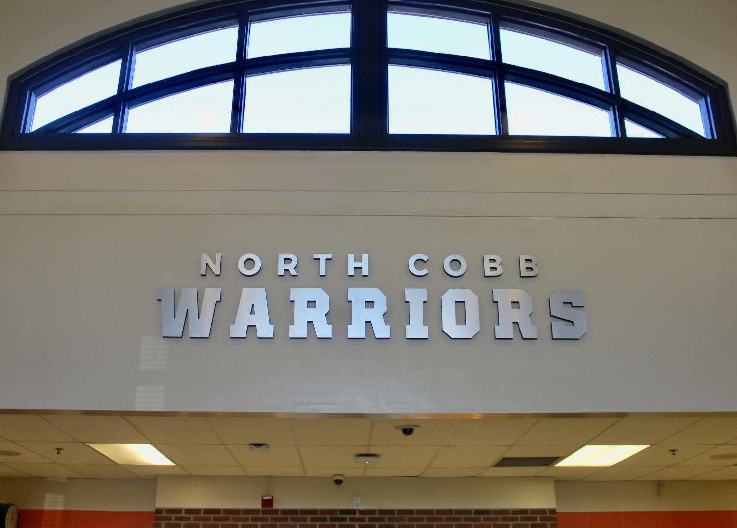 "NC welcomes students and visitors with a brand new sign located in the front lobby. As soon as people walk into the school, the shiny sign brightens their day. ""The sign adds a modern touch to North Cobb since many things found in this school are outdated,"" sophomore Abbey Corley said."