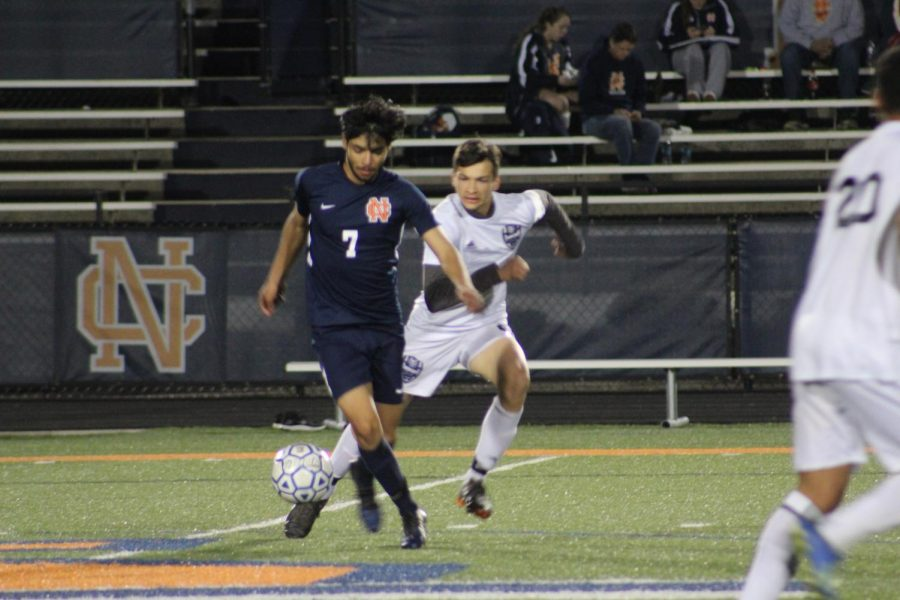 Senior+striker%2C+Bryan+Estrada%2C+defends+the+ball+leading+to+Marietta%E2%80%99s+goal.+Shortly+after%2C+Estrada+takes+a+shot+on+the+goal+and+misses+but+brings+it+back+with+a+free+kick%2C+and+puts+Warriors+ahead+1-0.+