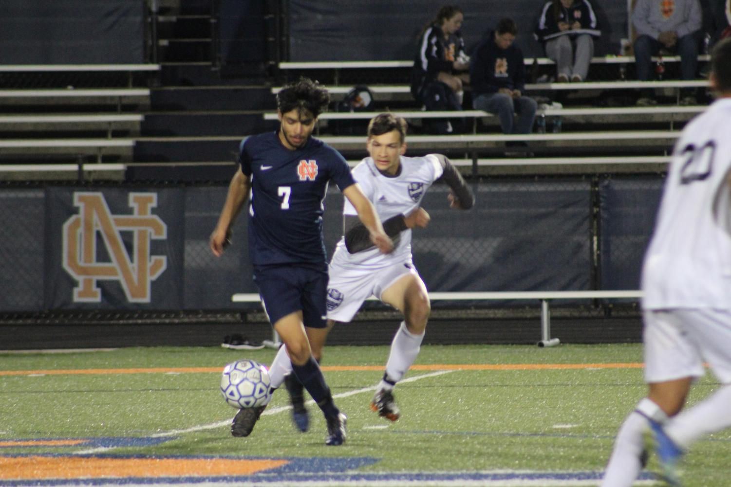Senior striker, Bryan Estrada, defends the ball leading to Marietta's goal. Shortly after, Estrada takes a shot on the goal and misses but brings it back with a free kick, and puts Warriors ahead 1-0.