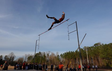 """Magnet sophomore Jackson Kutsche broke the previous school pole vaulting record to 14 feet and 7 inches after beginning as an outright rookie to the event his freshman year. Speaking about his recent break, Kutsche admits fear. """"I was scared as I was going down because my form was off and I fell off the mat,"""" Kutsche said."""
