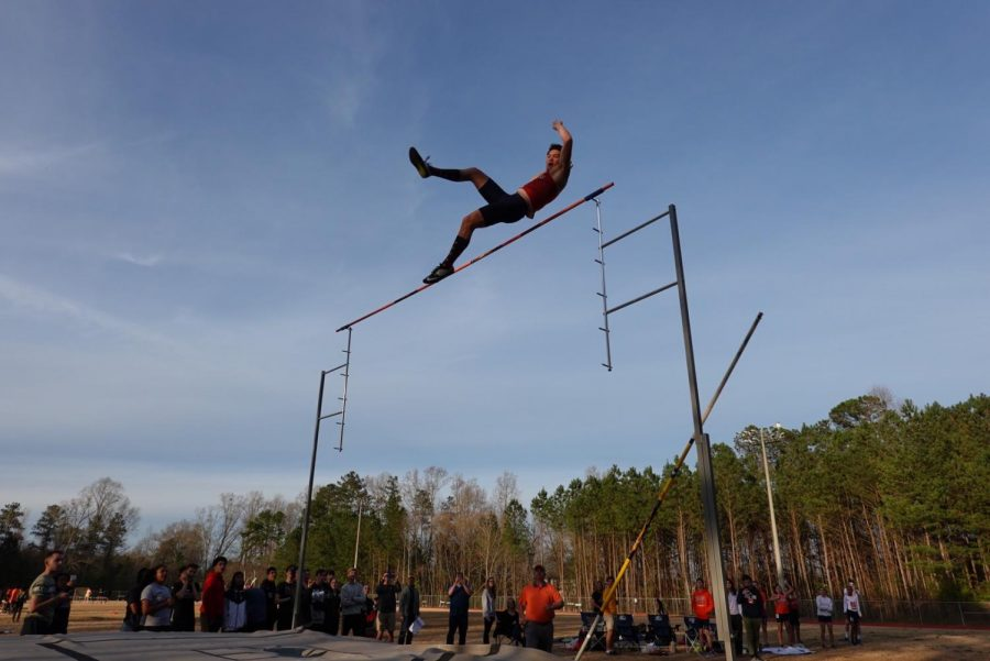"Magnet sophomore Jackson Kutsche broke the previous school pole vaulting record to 14 feet and 7 inches after beginning as an outright rookie to the event his freshman year. Speaking about his recent break, Kutsche admits fear. ""I was scared as I was going down because my form was off and I fell off the mat,"" Kutsche said."