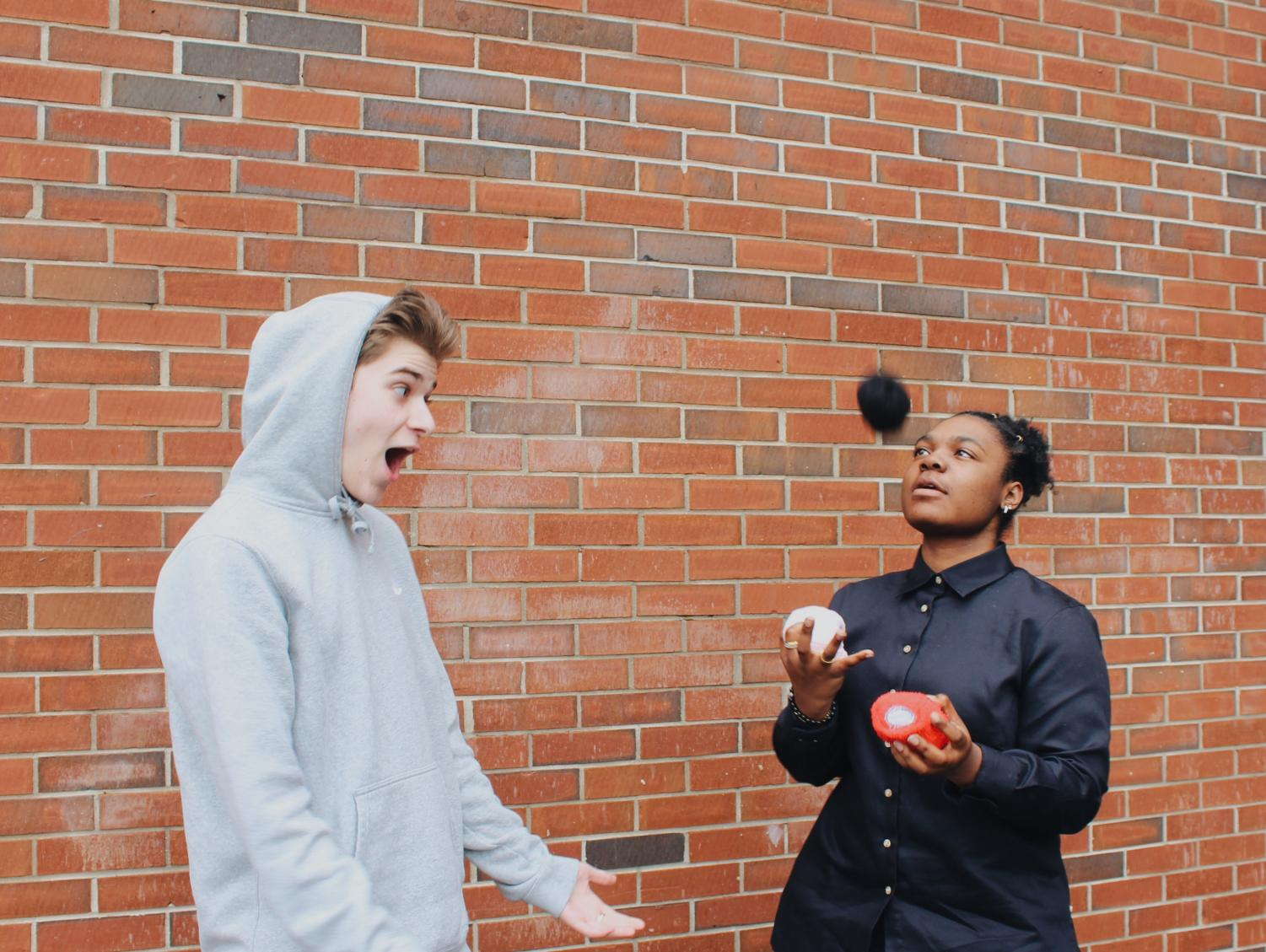 """Juniors Evan Chighizola and Skai Farmer practice juggling as spring approaches. Students engage in a variety of activities as the weather warms up, with juggling as a unique talent. Other activities, such as hiking and picnicking, allow students to enjoy the warmer weather. """"The weather being warmer is really making everyone happier and making us want to do more of the things we love,"""" Chighizola said."""