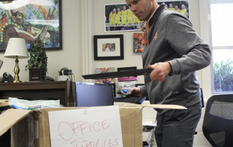 "Mr. Stephenson boxes up his belongings in preparation for the upcoming demolishing of his office. ""I love this office. It's been my home for several years, but I know that this ticket booth and theater is the best thing for North Cobb. I am ready for this new chapter,"" Stephenson said."