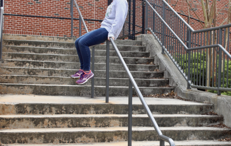"As Ore practices intensely for upcoming tryouts, she utilizes every obstacle in her path. On an average walk to class, she slides down the railing to increase her efficiency and continue training. ""What can I say? Parkour runs through my veins. I did not choose this sport, the sport chose me,"" Ore said."