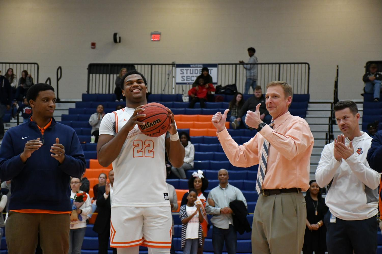 "Varsity Boys Basketball coach Terry Gorsuch accompanies senior player Kevin Hester during senior night, saying a farewell to a significant part of his 2018-2019 season coaching basketball. ""Each Senior group is special—these four seniors have been awesome and I will truly miss them. Shota Suzuki, Kevin Hester, Josh Moten, and Tyrese Crawford have done so much for the program the last four years,"" Gorsuch said."
