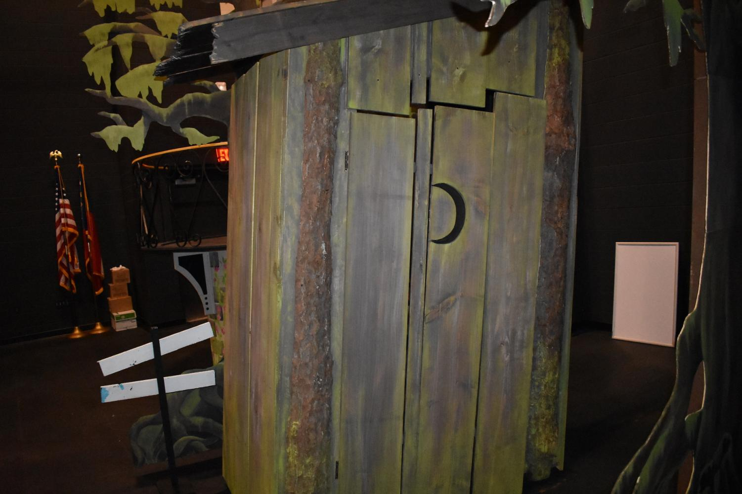 Shrek's hut, used for the NC Theatre Department's upcoming performance of Shrek The Musical, lays in the back of the stage. As the main set for the play, the majority of the student performers will play out their roles around this locale. First performed in 2008, seven years after the animated movie released, Shrek The Musical retells the events of the film (and the 1990 book it adapts), but with additional backstory for Shrek and Fiona. The NC production will essentially serve as a retelling of the original, with no notable difference.