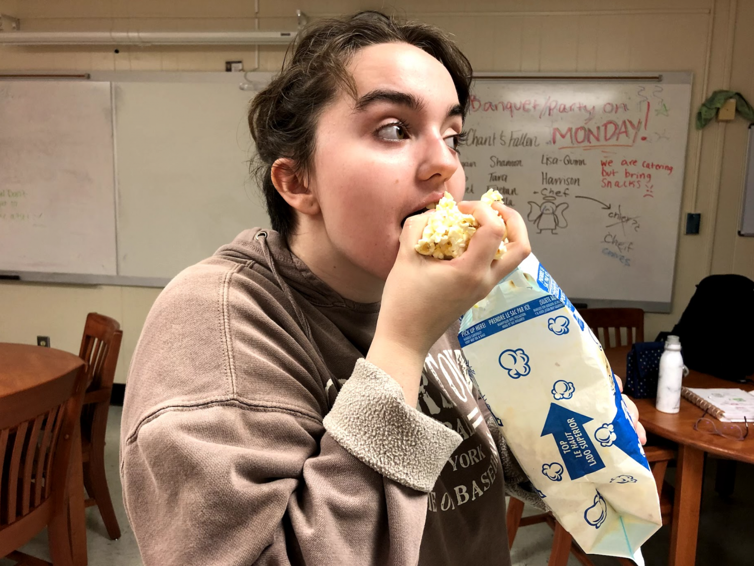 This movie-goer excitedly shoves popcorn in her mouth in anticipation for the upcoming movies that will release in theaters. Kennesaw/Acworth locals can find any of the upcoming films they wish to see at NCG, AMC at Barrett Commons, or Regal Cinemas at Town Center.