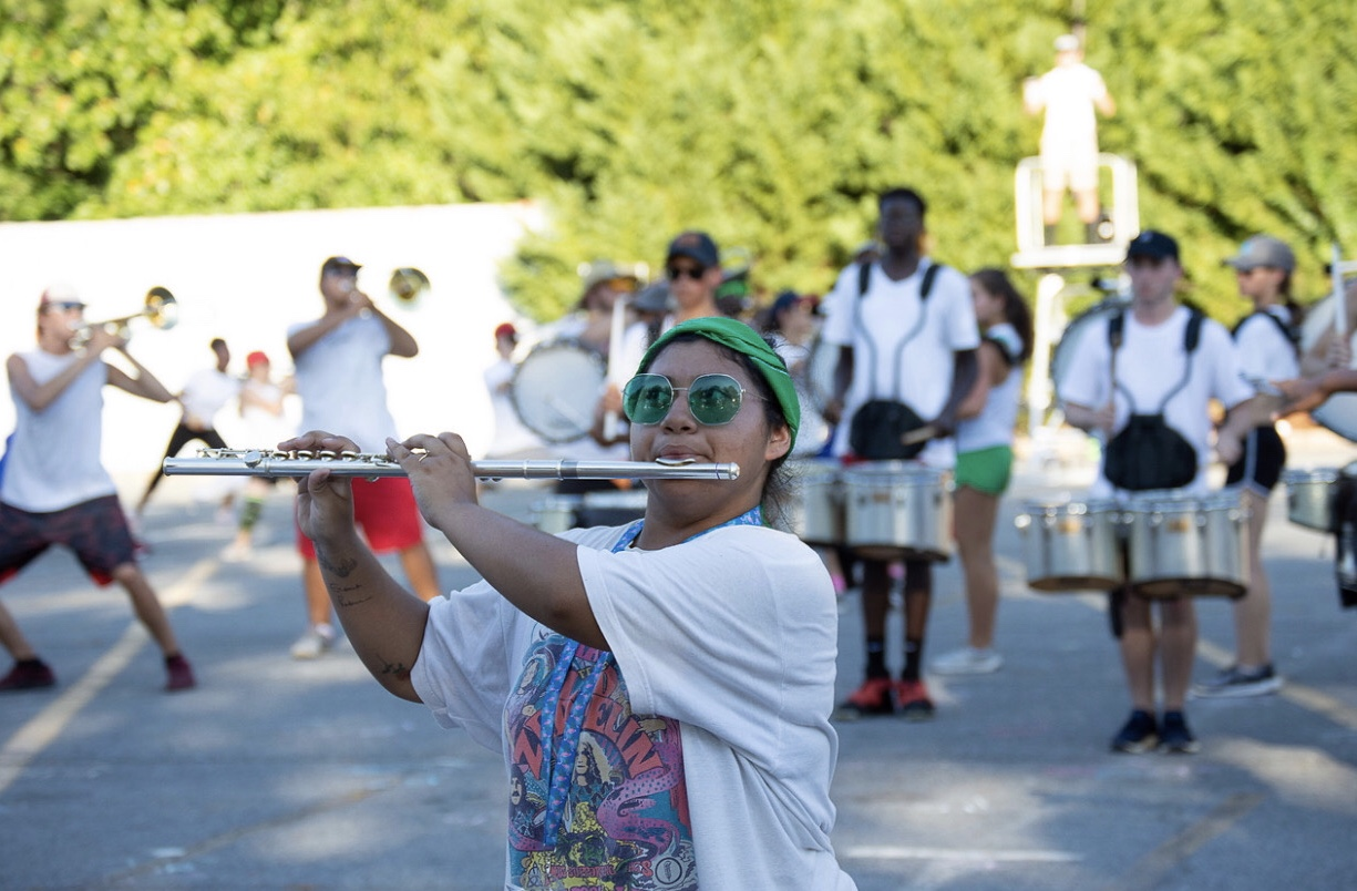 """As graduating senior Briana Rohlfs enjoys her last season as a flutist in NC's marching band, she reflects on what it takes to pull off a successful performance. """"There's a lot of emphasis on being a part of a team because if you're not there it ruins the whole form. Everyone depends on each other to make the show happen. Without one person the show would be completely different,"""" Rohlfs said."""