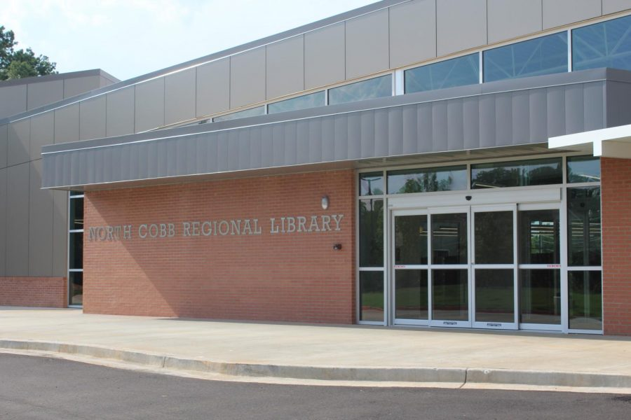 The North Cobb Public Library plans to open its doors within the next two weeks. A bittersweet miracle for the Kennesaw and Acworth areas. While patrons show disappointment in the closing of the libraries they grew up at, they appear excited about a larger working space and more community activities.