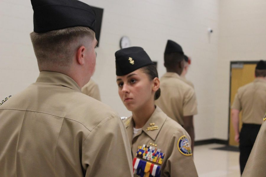 Newly named Commanding Officer Makayla Groves performs her duties during the weekly fourth block inspection.  Standing tall, she inspects her unit after a long day ensuring that there is still shine in their shoes and crisp folds in their uniforms. These necessary uniform traits earn points for the program at the spring evaluation, and the new CO cannot let anything slide this early in the year.
