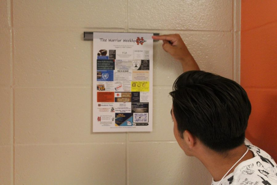Sophomore Lorenzo Alarcon closely examines the Warrior Weekly. Adopted from Harrison high school, Principal Moody hopes to replace North Cobb favorite, Tomahawk Today, with a weekly newsletter that includes information from an abundance of clubs.