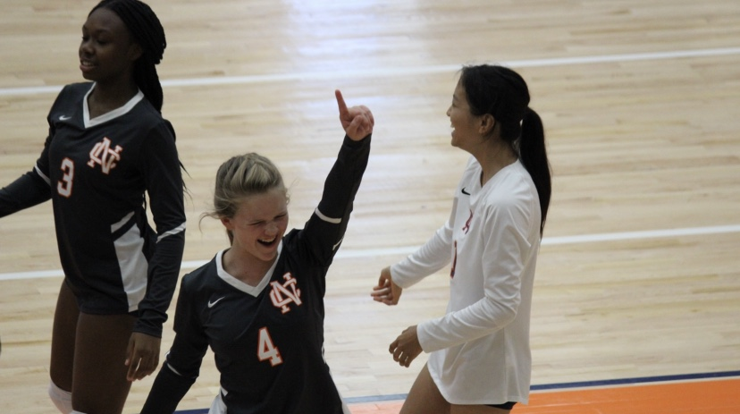 "North Cobb's Lady Warriors, Carson Walker, N'Jheri Mathew, and Serena Xu celebrate their victory of four wins and one loss at their tournament on Saturday. ""It felt great to have won four games after a whole day of competing, because we were all exhausted from playing,"" teammate Harmoney Harvey-Morris said."