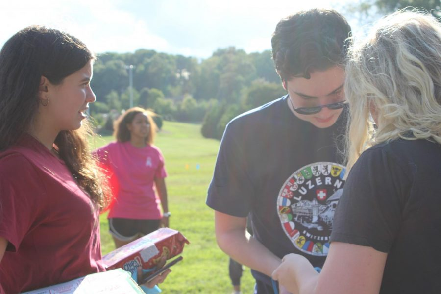 The social for NHS provided students their first community outreach opportunity. Magnet students Katie Word, Ilias Clark, and Maggie Glancy enjoy a conversation in the park after dropping off their donations for a local organization helping children who cannot afford school supplies.  Like their peers, they hope to make the most out of their opportunity.