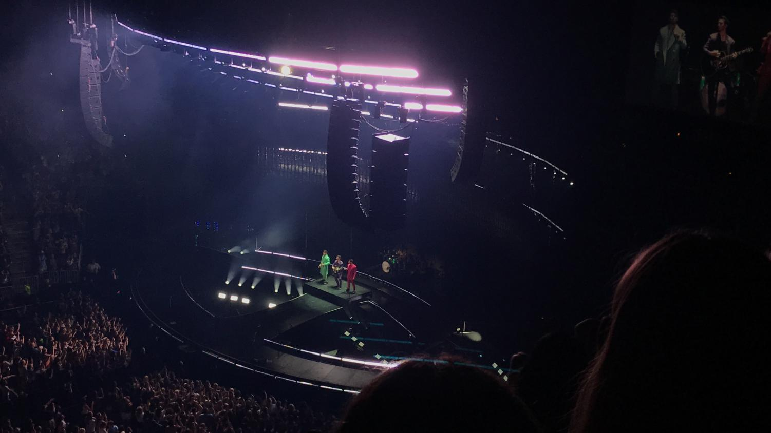 """The Jonas Brothers start off their Happiness Begins tour with their song """"Rollercoaster"""" while coming down a moving platform from the top of the stage to the middle. While the platform moved, fireworks and sparks went off exciting the crowd. This amped up the crowd preparing them for the rest of the two-hour show."""