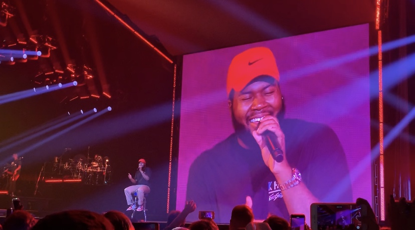 """Khalid sings the ballad """"Heaven"""" from his most recent album, Free Spirit. The lights dimmed to perfectly accommodate the mood and emotion of the song. Khalid's high-pitched vocals during the verses led the crowd to sway to the melody."""
