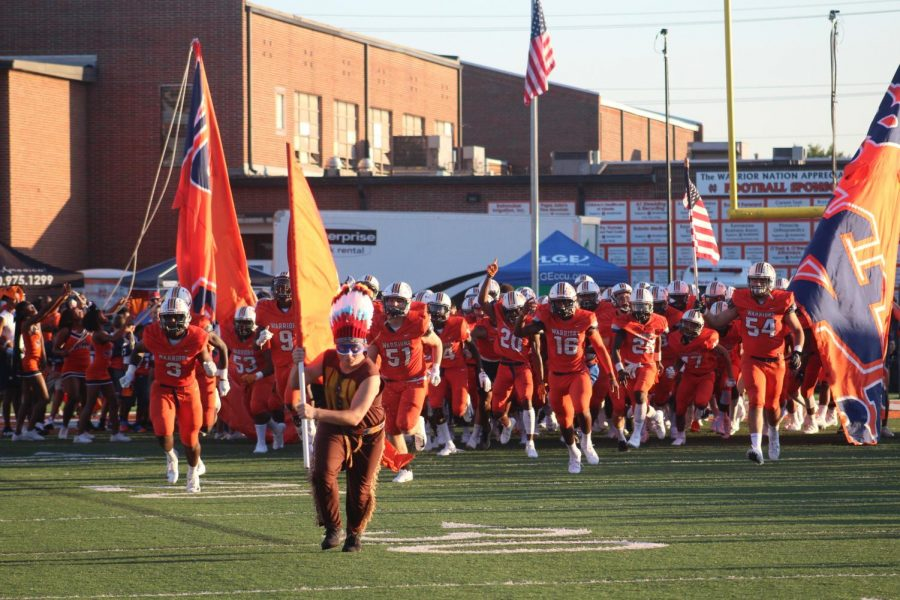 """The 2019-2020 NC Varsity football team continues the traditional banner run, led by the controversial Warrior mascot. The NC offense went on a rushing and passing frenzy, racking up over 400 yards in a 42-10 win over the Etowah Eagles. """"Every year we play them, it's a dogfight,"""" said Head Coach Shane Queen."""