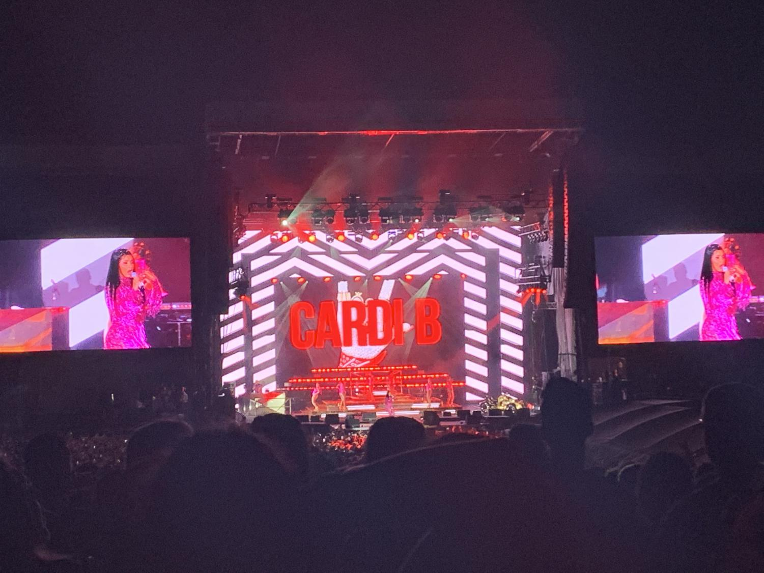 """Cardi B's flamboyant performance gripped fans as people sang and danced along to her most famous songs: """"Bartier Cardi"""", """"Money Bag"""", and """"Bodak Yellow."""" """"Cardi B's performance had fire and strobe lights, so it was very energetic. Everybody was dancing around me. It even ended with fireworks,"""" junior Skylar Chan said."""