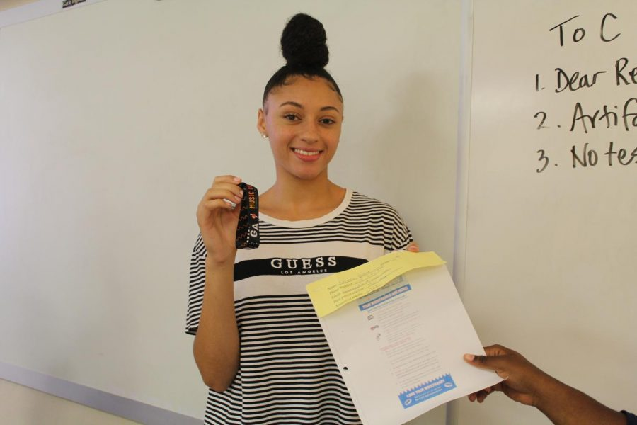 """Winners, Senior Rachel Charleston and Junior Kalana Garner, received the winning wristbands for Music Midtown this upcoming weekend. Garner bought two tickets and paid only $10 for the price of a $150 worth ticket. Garner's winning ticket estimated 1,978 M&M's, and she jokingly wrote """"#Winner!"""" on the back of her ticket. To their surprise, their weekend will consist of live music of their favorite artists."""