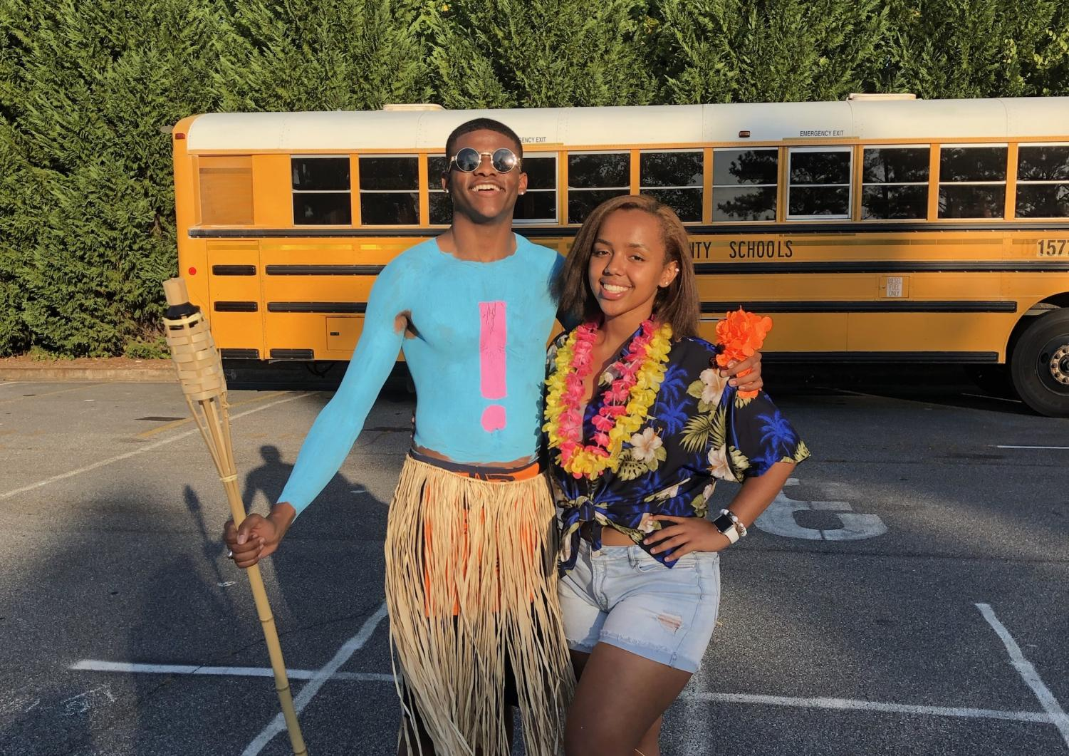 "Josh Hollis and close friend Rahel Kefetew take pictures before the football game against Campbell. Both students enjoy spending time together outside of school; Friday games provide them the perfect, positive location they need. ""I love being friends and spending time with Josh! He is always so positive and uplifting and brings joy to every conversation we have,"" Rahel said."
