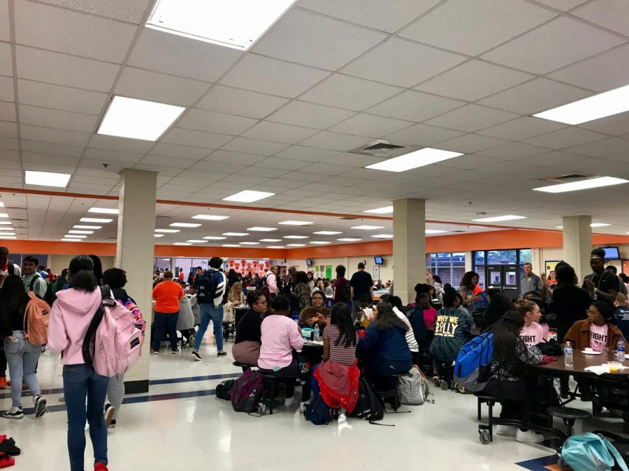 Seniors+enjoyed+doughnuts+for+breakfast+treated+to+them+by+NC.+As+students+entered+the+cafeteria%2C+they+encountered+long+tables+filled+with+orange+juice%2C+apple+juice%2C+Krispy+Kreme+donuts%2C+granola+bars%2C+and+fruit.+%E2%80%9CI+thought+it+was+a+nice+touch+%5Bthe+breakfast%5D+for+them+to+give+us+free+food+in+our+last+year+here.+I+really+appreciate+this+school+and+everything+they+have+done+for+me+as+a+student%2C%E2%80%9D+said+senior+Anthony+Miranda.
