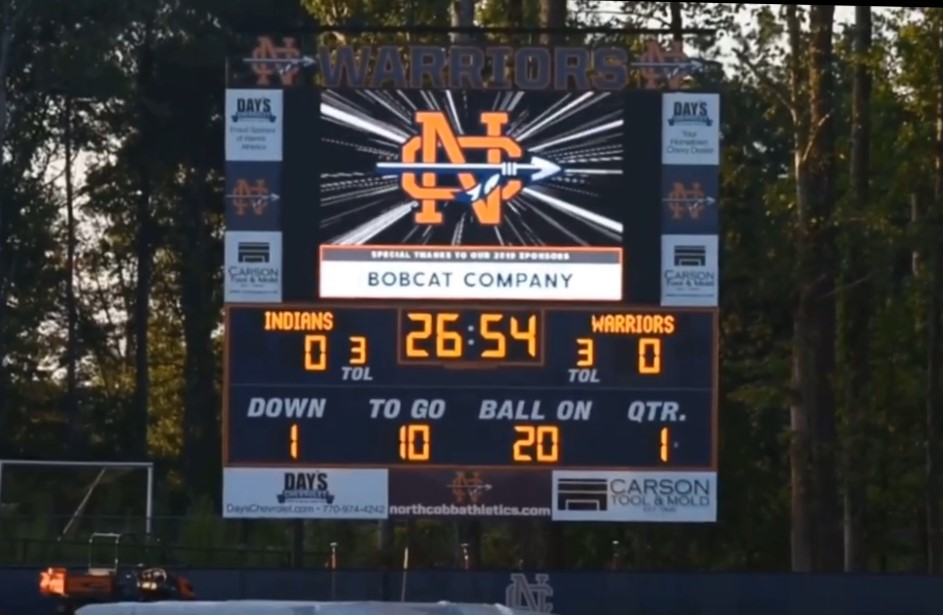 """Any student, player, or community member in attendance of an NC Warrior football game, will now experience the nostalgic 61-year history of the NC Warrior football team thanks to a video made by Dallas White. Displayed on the newly funded jumbotron, chilling narration mixed with spectacular plays by Warrior football greats highlight and set the tone for each home game. Followed by the traditional banner run, fans rise from their seats, waiting for the Warriors to strike again. """"I hope it helps the student body appreciate the history and tradition of our program. We have an incredible band, student section, and cheerleaders, but I'd love to see more students showing up on Friday nights,"""" White said."""