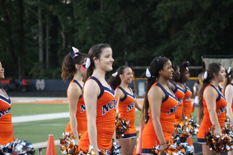 "NC junior Daniela King and her teammates cheer on the varsity NC football team every Friday night. The girls treasure their time spent cheering together and look forward to it every week. The cheerleaders enjoy supporting their football team along with the avid fans in the stands. ""It's very fun to see the crowd cheering on the team with us,"" King said."