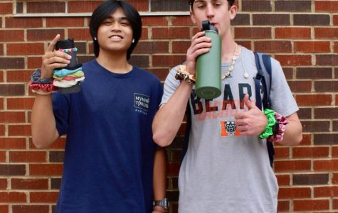 """Seniors Ryan Getz and Sam Lacandazo """"and I oop-ed"""" their way through Tik Tok Tuesday, imitating the popular stereotype of VSCO girls on the app. The seniors did not show fear to come out in their shorts on a chilly day to show their appreciation for NC."""