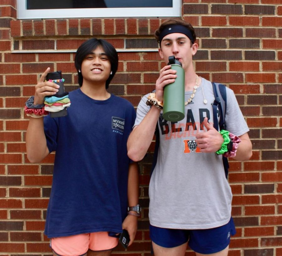 "Seniors Ryan Getz and Sam Lacandazo ""and I oop-ed"" their way through Tik Tok Tuesday, imitating the popular stereotype of VSCO girls on the app. The seniors did not show fear to come out in their shorts on a chilly day to show their appreciation for NC."