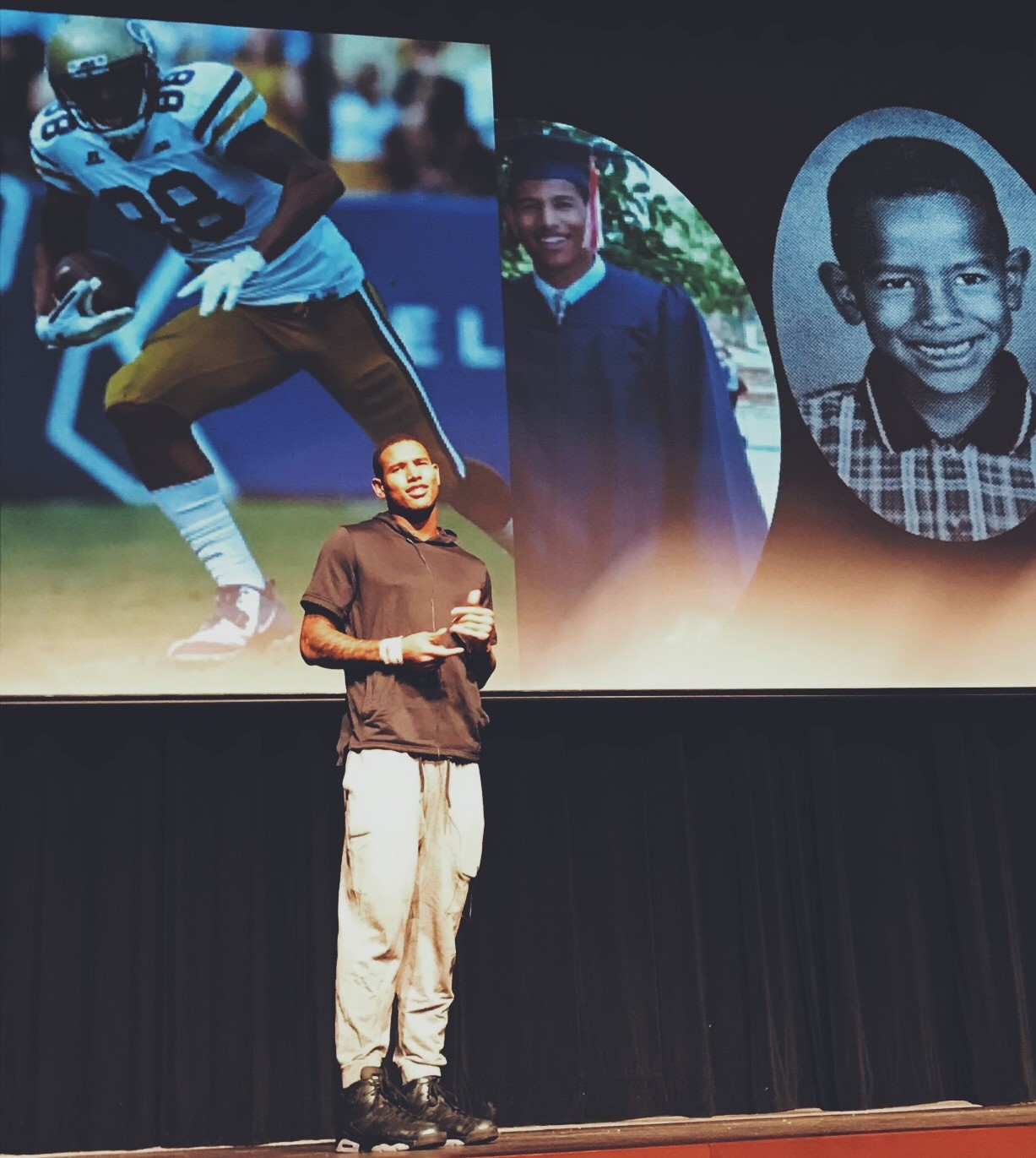 Oakland Raiders' Darren Waller stands on the stage of NC's Performing Arts Center, in front of pictures of his younger self. The theatre packed in listeners with a variety of questions to ask Waller after his emotional speech. Waller joins the crowd outside the auditorium after the presentation comes to a close, taking pictures with fans young and old.