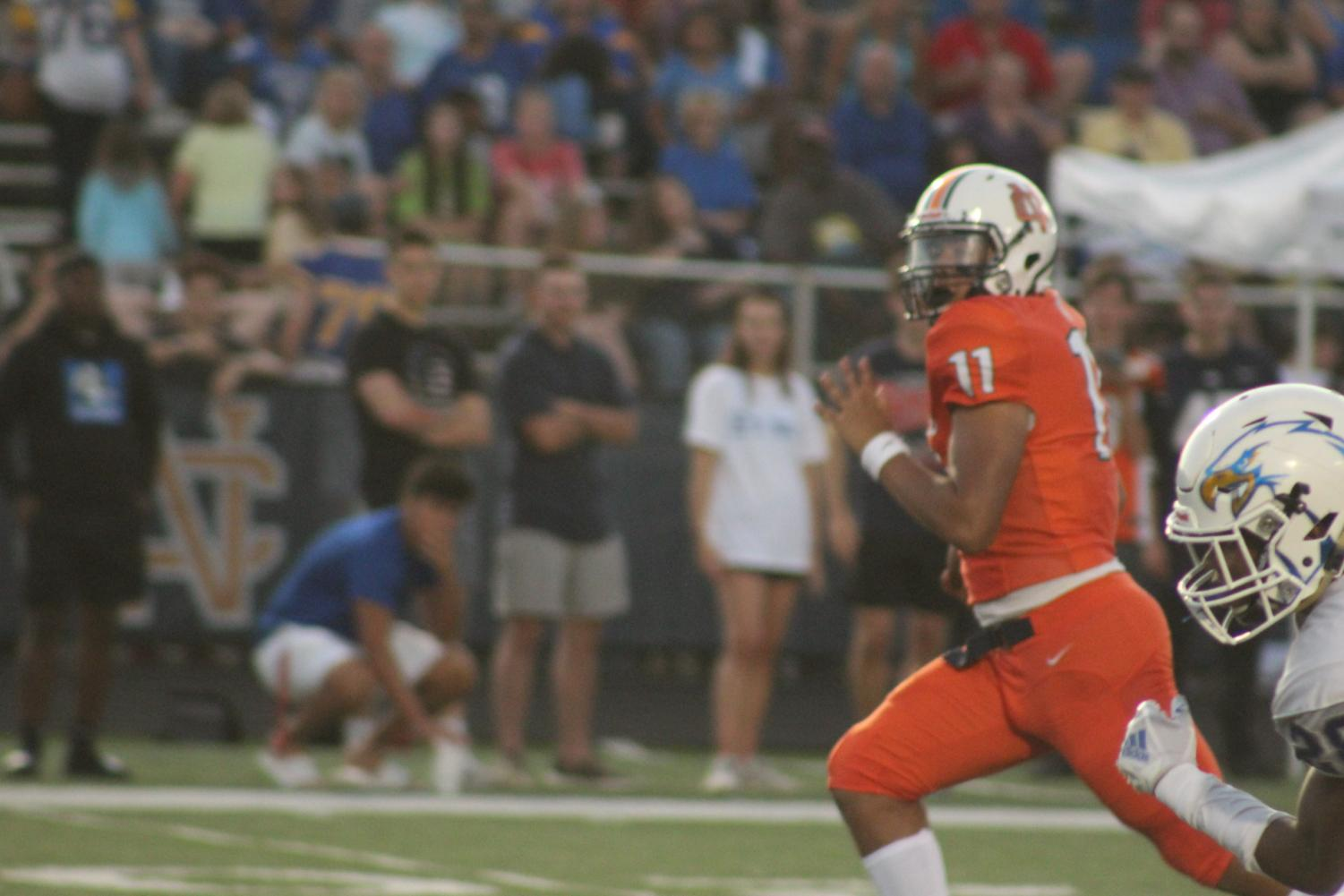 """After receiving the starting quarterback position over junior quarterback Trevor Lovett for the second week in a row, freshman phenom Malachi Singleton (pictured above) faced trouble in his second career start. Though posting over 100 yards of total offense, Singleton did not find the endzone friendly, unlike a week prior where he scored 4 touchdowns. """"Malachi did well for only his second game. Colquitt County is just an unreal team,"""" sophomore linebacker Vernard Martin said."""