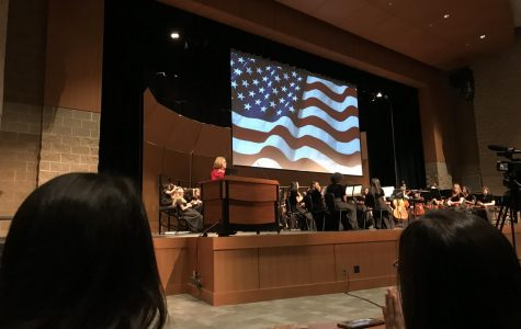 Assistant Principal Mary Goodwin recites a poem pertaining to veterans, making them feel welcomed at  NC and honoring them for their accomplishments. NC students gathered in the Performing Arts Center (PAC) to thank those who fought for their freedom and rights. Students and faculty felt moved by the service and in the end, everyone cheered for those who risk it all.