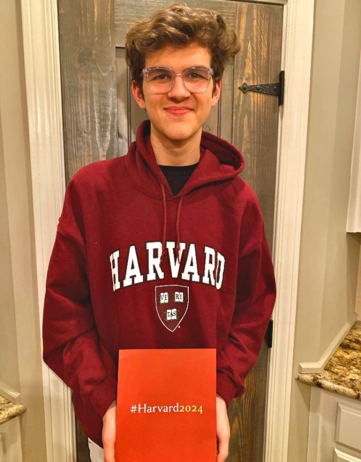Harvard-bound+NC+Magnet+senior+Chandler+Quaile+opens+his+acceptance+letter+to+the+prestigious+school.+What+seemed+just+as+impossible+as+getting+a+letter+to+Hogwarts%2C+Quaile+proved+worthy+of+earning+acceptance+into+his+dream+school.+