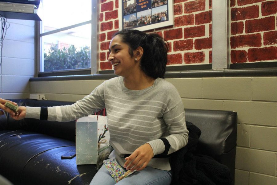 "Magnet senior Ana Barahona sells a cookie to a hungry student as a way to earn money. However, she plans to use the money in a unique way to help others instead of spending it herself. ""In the spring, I'm going to a special needs school in Honduras, and I'm using the money to pay for shipping for clothes and school supplies. I needed a way to get money instead of just asking people, so I decided to have a Christmas bake sale,"" Barahona said. Students can find her in the Magnet Lounge selling Christmas tree rice krispies, hot chocolate cookies, and white chocolate popcorn for $1.50."