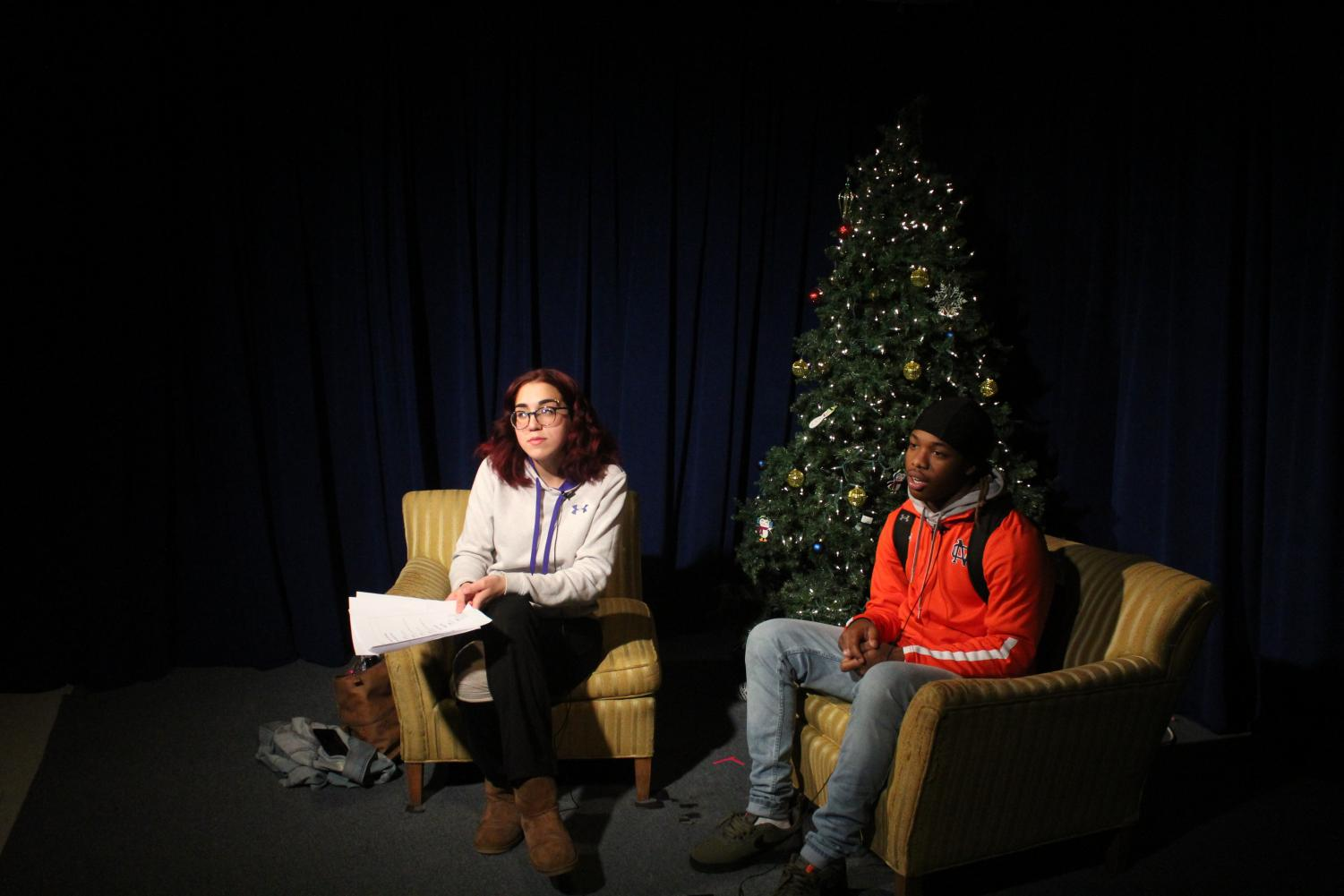 Cassia Dunlap and Gerald Harris receive instruction as they prepare to film a show similar to Tomahawk Today. Those enrolled in the Audio-Video Technology and Film pathway learn to produce more than the regular news package shown first thing in Homeroom; they also learn scripting, writing, filming, and editing for creative projects such as the one shown.