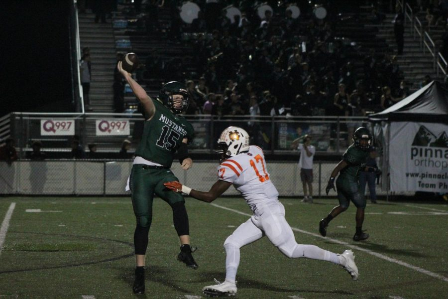 In NC's sixth game of the season against the Kennesaw Mountain Mustangs, senior middle linebacker Grant Wooten pursues the Mustang quarterback, almost colliding helmet to helmet. As the quarterback throws in motion, he lands in the defenseless position, allowing the chance of a TBI to occur. If Wooten did not properly tackle below the waist, the Mustang quarterback and Warrior defense may both receive a negative outcome.
