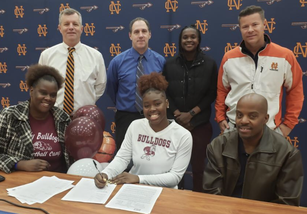"NC senior Azonya Austin signed with Alabama A&M on November 13, at a ceremony in the arena, surrounded by family, friends, and supporters.  After playing  NC basketball for the entirety of her career, Austin prepares for the transition from high school to college and reflects on what high school ball taught her. ""It's going to be a whole different atmosphere. College [basketball] is ten times harder than high school [basketball]. In high school, you just go to school go to practice and go home… [in college] my whole day will revolve around basketball, and on top of that, I have to be a student-athlete."""